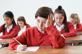 Male Pupil Finding School Exam Difficult